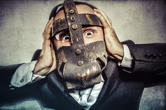Pulling, dangerous business man with iron mask and expressions Royalty Free Stock Photo
