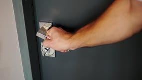 Pulling the doorknob male hand metal doorknob