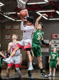 Pulling Down the Rebound. Basketball players in action in the city of Redding, California Royalty Free Stock Images