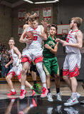 Pulling Down the Rebound. Basketball players in action in the city of Redding, California Stock Photo