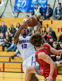 Pulling Down The Rebound. A Shasta player  (white) pulls down the rebound during a basketball game against  Foothill in Redding, California. December 5, 2015 Stock Images