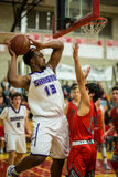 Pulling Down The Rebound. A Shasta player  (white) pulls down the rebound during a basketball game against  Foothill in Redding, California. December 5, 2015 Royalty Free Stock Images
