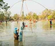 Pulling fish net in thailand. Royalty Free Stock Photos