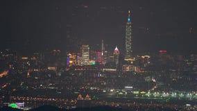 Pulling focus of Taipei city with bokeh circles of night , Taiwann stock video footage