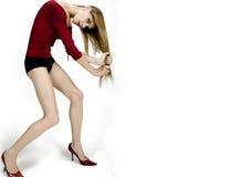 Pulling hair. Beautiful fashion model pulling her blonde hair Stock Image