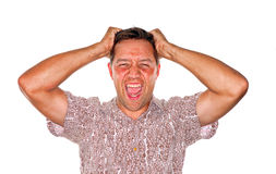 Pulling hair out. Stressed man who is losing control and pulling out hair Royalty Free Stock Photos