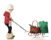 Pulling a Heavy Christmas Load Royalty Free Stock Image