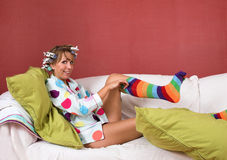 Pulling on my funny socks Stock Images