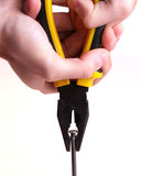 Pulling a nail with pliers. Stock Photo