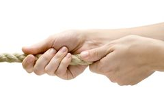 Pulling Near. Female hands pulling a rope. Isolated on a white background Stock Photography