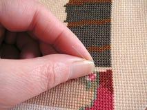 Pulling needle through Royalty Free Stock Photo