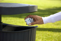 Pulling the paper into the trash, ecology and en Royalty Free Stock Photography