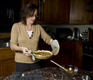 Pulling a Pecan Pie out of the oven Royalty Free Stock Photo