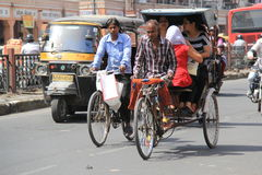 Pulling a Rickshaw in heat Royalty Free Stock Image