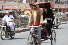 Pulling a Rickshaw in heat Stock Images