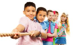 Pulling the rope. Diversity kids boys and girls buplling the rope isolated on white Stock Images
