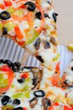 Pulling single slice of pizza Royalty Free Stock Image