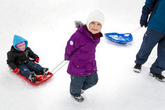 Pulling sister in sled Stock Image