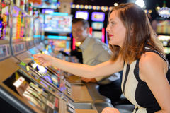 Pulling slot machine ticket Stock Image