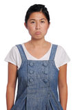 Pulling a sour face. Asian girl is grumpy and uhappy Stock Images