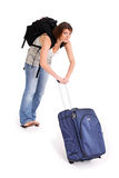 Pulling suitcase Royalty Free Stock Photos