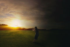 Pulling the sun to the darkness Royalty Free Stock Image