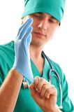 Pulling on surgical glove Royalty Free Stock Photos