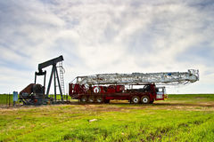Pulling Unit. Oil Field Pulling before the derrick is errected Stock Image