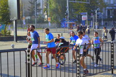 Pulling wheelchair runners Sofia Bulgaria Royalty Free Stock Image