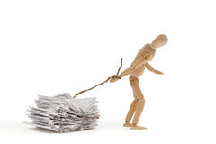 Pulling your weight. A person pulls his weight with heavy debt Royalty Free Stock Photo