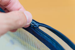 Pulling Zipper Royalty Free Stock Photos