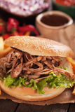 Pullled pork burger sandwich. American pulled pork burger sandwich with lettuce salad Royalty Free Stock Photography