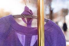 Pullover hanging on a wardrobe rail Stock Photos
