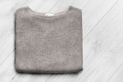 Pullover on wooden background Royalty Free Stock Images