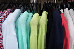 Pullovers on hangers. Royalty Free Stock Image
