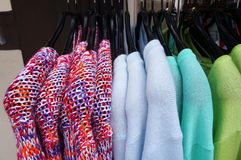 Pullovers on hangers. Stock Photography