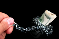 Pulls money from the chain. On a black background royalty free stock images