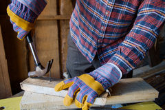 Pulls out a nail Royalty Free Stock Images