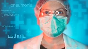 Pulmonologist healthcare professional in hospital clinic. Portrait of female medical specialist treating lung diseases such as asthma, bronchitis, pneumonia royalty free stock images