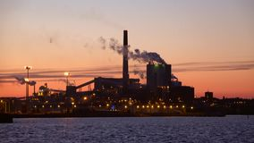 Pulp and paper mill `Sunila` at sunset. Kotka, Finland