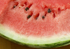 Pulp of a water-melon. Watermelon cut shot in natural light. The ripe and fresh pulp contains clear water, cellulose and microcells useful to health Royalty Free Stock Image