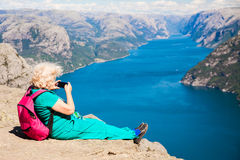 Pulpit rock with elder woman Royalty Free Stock Photography