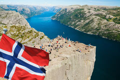 Pulpit Rock in Norway with flag Royalty Free Stock Photos