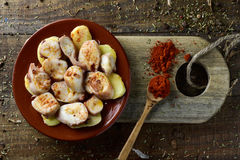 Pulpo a la gallega, a recipe of octopus typical in Spain. High-angle shot of an earthenware plate with pulpo a la gallega, a recipe of octopus typical in Spain Royalty Free Stock Photo