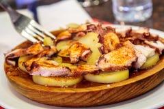 Pulpo a la gallega in street food la Boqueria Stock Photo