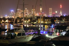Pulsating City At Harbor With Sailing Boats By Night Stock Images