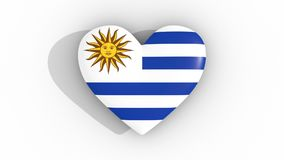 Pulsating heart in the colors of Uruguay flag, on a white background, 3d rendering top, loop. Pulsating heart in the colors of Uruguay flag, on a white stock video footage