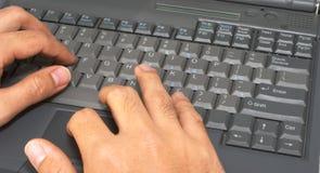 Pulse en el ordenador portátil #2 Foto de archivo