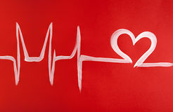 Pulse of a man in love. Irregular pulse painted on a red background in the form of heart Stock Photo