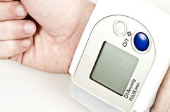 Pulse meter. Isolated pulse meter on male hand Royalty Free Stock Photo